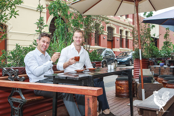 • Fremantle mayor Brad Pettitt and Moore and Moore Cafe owner Simon Naber get cosy in the cafe's urban garden in Henry Street. Photo by Jeremy Dixon