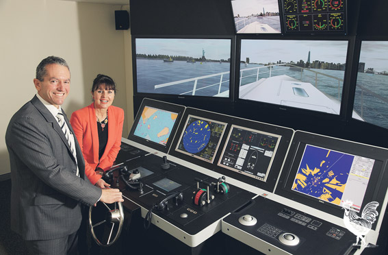 • Training minister Terry Redman and Challenger boss Liz Harris check out the simulator.