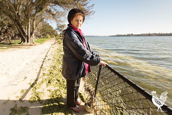 • Dawn Davies down at the foreshore that will soon be ceded to the Swan River. Photo by Matthew Dwyer