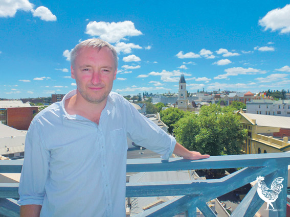• National Hotel owner Karl Bullers enjoys his view.