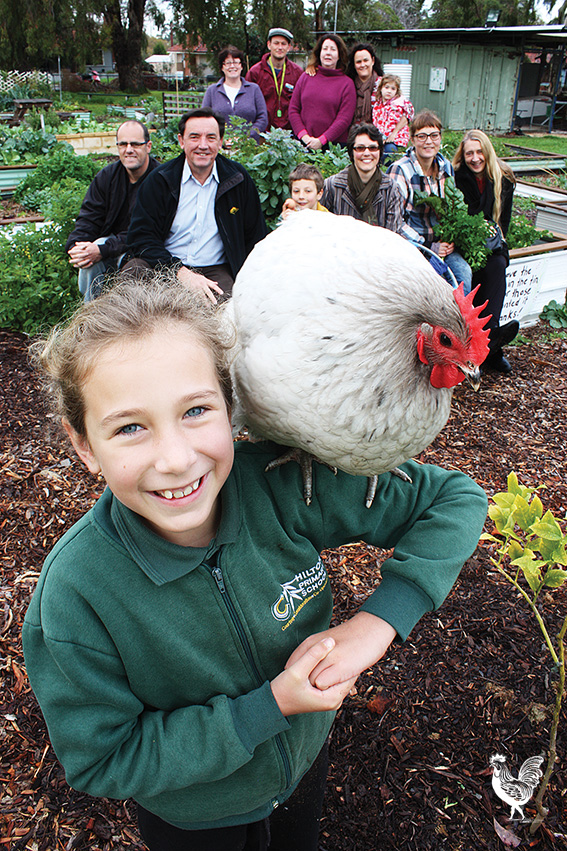 • Chook whisperer Freda Rule and pal Tracey Sketchit with courageous Harvest Community Garden supporters. Photo by Steve Grant.