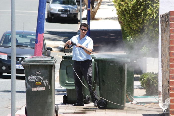 • A high-pressure spray leaves the Tradewinds' bins clean, but a local businessman says the grime and smell is putting his customers off.