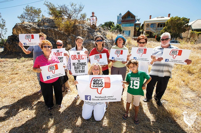 • Residents in the Burt Street precinct are fighting a losing battle to stop a massive rezoning opposite their homes. Front (l-r): Eileen English and Leighton Stringer. Middle: Elena Morgillo, Nanette Hassall, Christine Loundes, Rosalie Dwyer, Hilary Hodgson, Bruce Maluish. Rear: Dawn Featherby and Tony Morgillo). On the rock: Wayne Williams. Photo by Matthew Dwyer