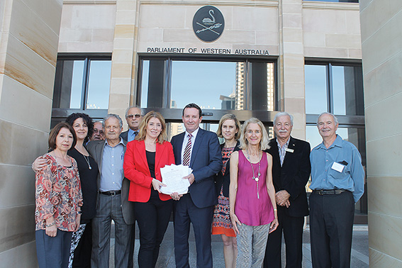 • Labor MPs Rita Saffioti (in red), Mark McGowan (opposition leader) and Freo's Simone McGurk with members of WA's Italian communities and a 6000-signature petition.