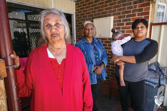 • Marie Thorne and Catherine Porter support Venadene Lee and daughter Medina outside their Hamilton Hill home. Photo by Matthew Dwyer