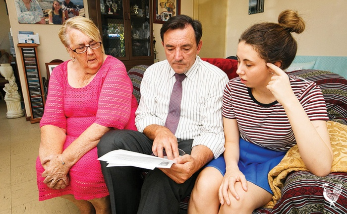 • Coralie Denney and grand-daughter Deni Campbell show Peter Tinley how higher rents will impact their budget. Photo by Matthew Dwyer