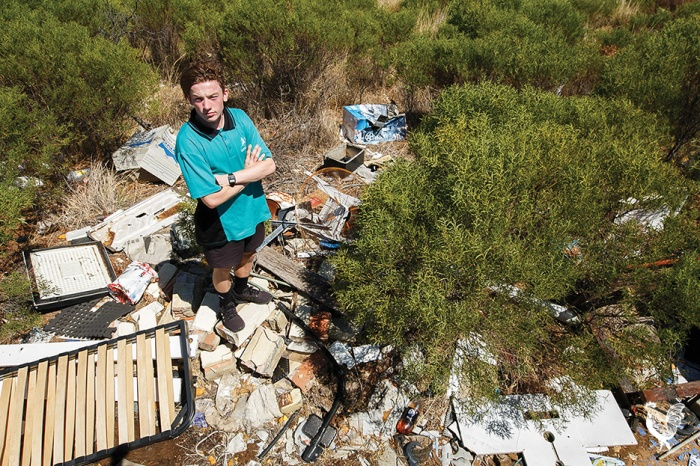 • Neil Robinson next to illegally dumped rubbish in Wattleup (photo by Matthew Dwyer) and, inset, Neil's photo of an alleged dumper caught in the act.