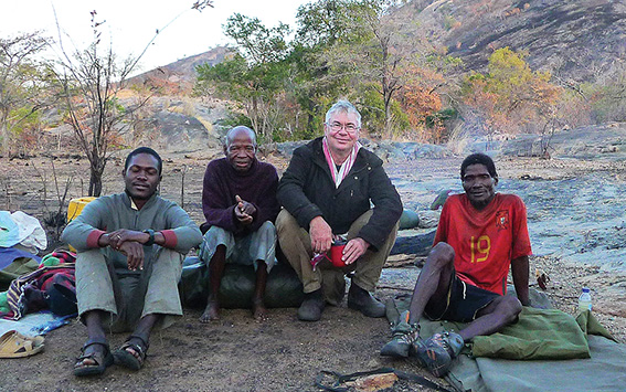 • Artist and scientist Anthony Cunningham (scarf, glasses) with pals in Africa.