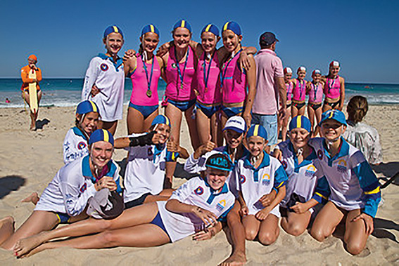 • Six-time gold medallist Ellie Fry and  Fremantle Surf Club's nippers.
