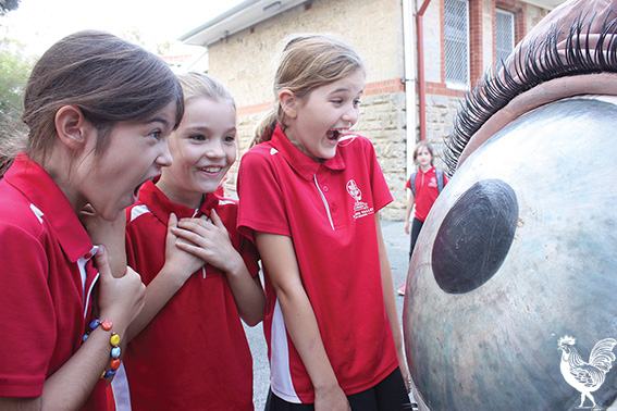 • Greer, Rita and Nina see eye to eye with a Snuff Puppet at White Gum Valley primary. Photo by Steve Grant
