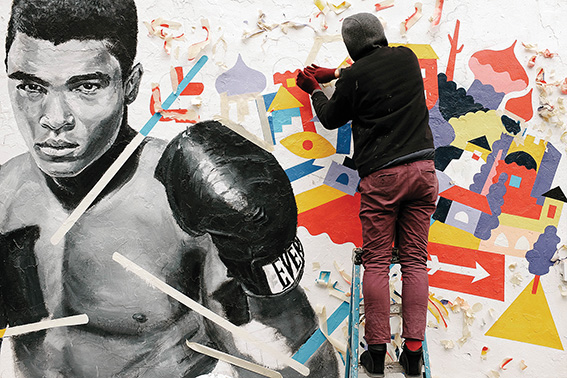 • Former Fremantle street artist Brolga working on his tribute to Muhammad Ali, which has become visited by countless Brooklyn fans of the former world heavyweight champion. Photo supplied