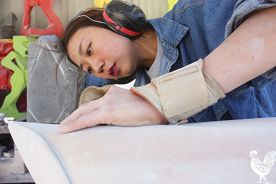 • Stone sculptor Jina Lee works on a piece for her exhibition Dreaming Stone. Photo by Steve Grant