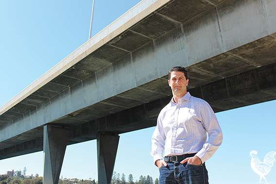 • Independent candidate for Bicton, Steve Kepert, under Stirling bridge, which might be the sole link to Fremantle Port in the PFL. Photo