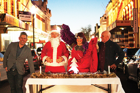 • Mayor Brad Pettitt with National Hotel owner Karl Bullers (Santa Claus), MC Famous Sharron and St Pat's CEO Steve McDermott. Photo by Trilokesh Chanmugam