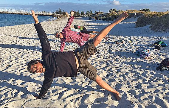 • Joe Surace leads a beach yoga session.