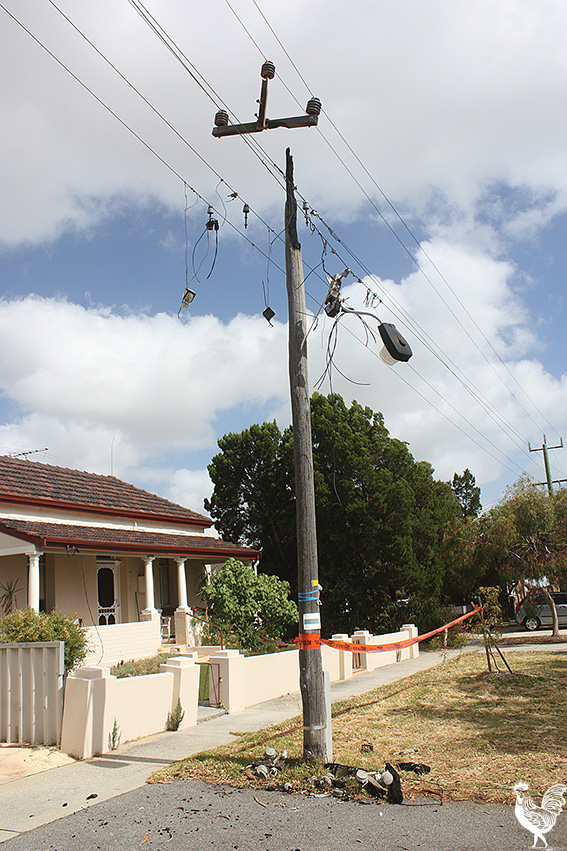 • Despite the top burning off and dangling wires, Western Power workers decided this small strip of plastic tape was enough to make this pole safe. Photo by Stephen Pollock