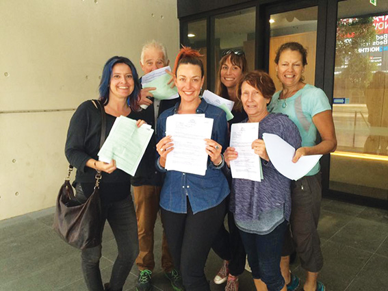 • Cr Pemberton and other Roe protestors proudly display their charges after being released on bail. Photo supplied