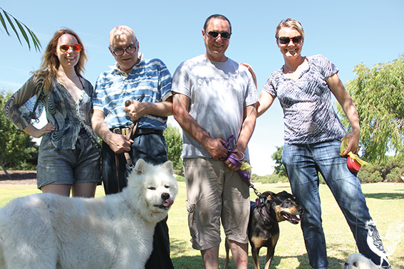 • Dog groomer Caroline Gray with locals Steve Mitchell and Susie Hawkins would love to see an off-leash area at Booyeembara Park. Photo by Stephen Pollock